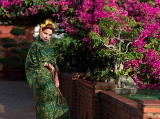 Beautiful woman in Geisha kimono in a garden