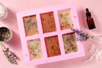 Handmade soap, the process of making. Glycerin with herbs, poured into a special mold for drying, shot from the top