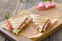 Grilled sandwich with salami and cheese