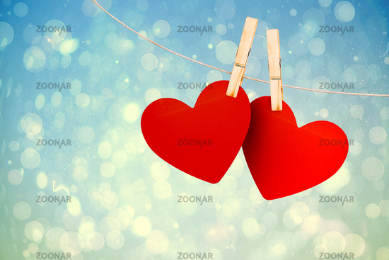 Composite image of hearts hanging on line