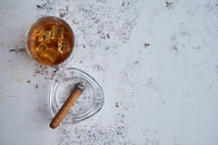 Whiskey or brandy in a glass with Cuban cigar