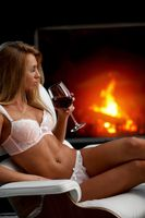 Woman in lingerie near fireplace