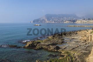 Mediterranean coastline at foggy morning with sunshine, Calpe, Spain