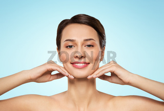 beautiful young woman touching her face and chin