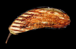 Grilled eggplant in black background
