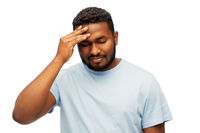 stressed young african american man with headache