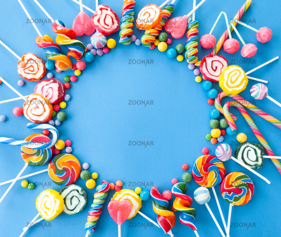 Colorful candy on blue background