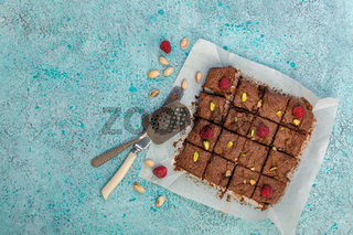 Traditional brownie with fresh raspberries and pistachios.