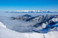 Winter Mountains and Light Fog in the Valley