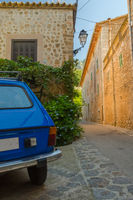 A little blue car in the back streets of Biniaraix