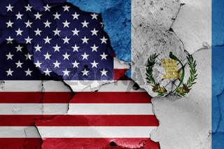 flags of USA and Guatemala painted on cracked wall