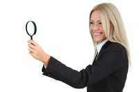 Business woman with magnifier