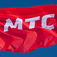 Flag waving in wind with text in Russian: MTS Mobile TeleSystems, abbreviation mobile operator