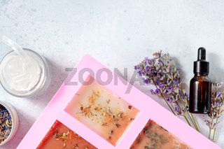 Handmade soap, the process of making . Glycerin with herbs, poured into a special mold for drying