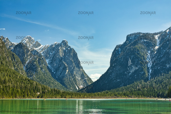 The Dobbiaco Lake in South Tyrol in front of a mountain panorama