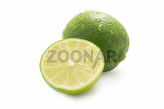 Sweet limes with leaf  - one sliced - isolated against white