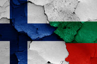flags of Finland and Bulgaria painted on cracked wall
