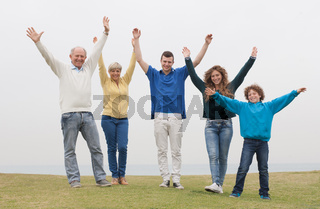 Happy family raised their hands