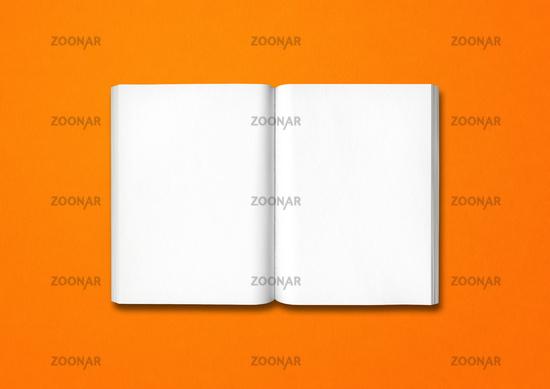 Open book isolated on orange