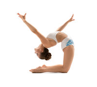 Beautiful female gymnast stretching and exercising