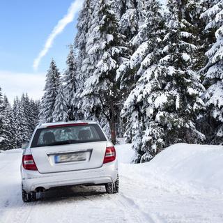 Car driving in winter landscape