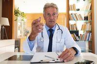 Portrait of senior caucasian male doctor in office