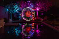 Light painting with colorfully illuminated trees