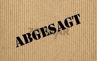 Abgesagt (Cancelled) on cardboard