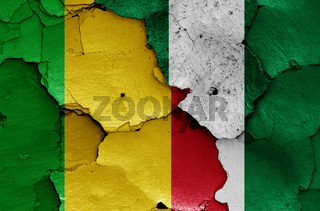 flags of Mali and Nigeria painted on cracked wall