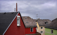 The chimney behind the roofs of the the small town