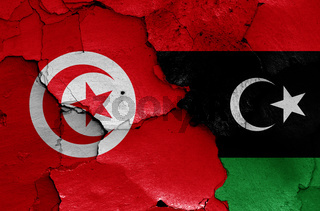 flags of Tunisia and Libya painted on cracked wall