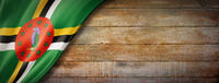 Dominica flag on vintage wood wall banner