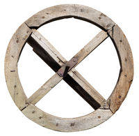 Aged wooden wheel from a water mill as a time machine concept isolated