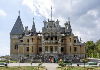 Massandra Palace on a cloudy day, illuminated by the sun. City of Yalta, Republic of Crimea, Russia. September 8, 2020