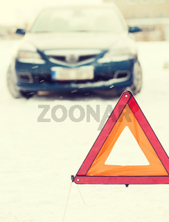 closeup of warning triangle and car