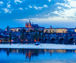 View of Charles Bridge and Prague Castle in dusk