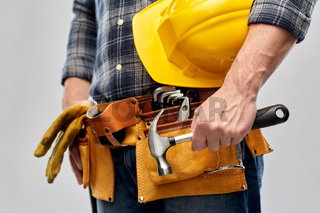 worker or builder with hammer and working tools