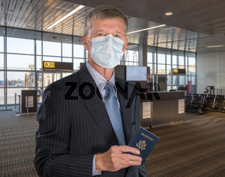 Senior man wearing face mask as protection against virus at airport