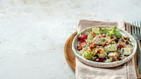 Waldorf salad on gray cement, copy space