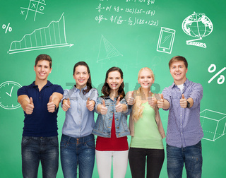 group of smiling students showing thumbs up