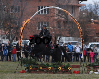 Bulgarian men ride their horses during celebrations marking the traditional holiday Todorov den