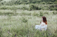 Young woman resting in countryside