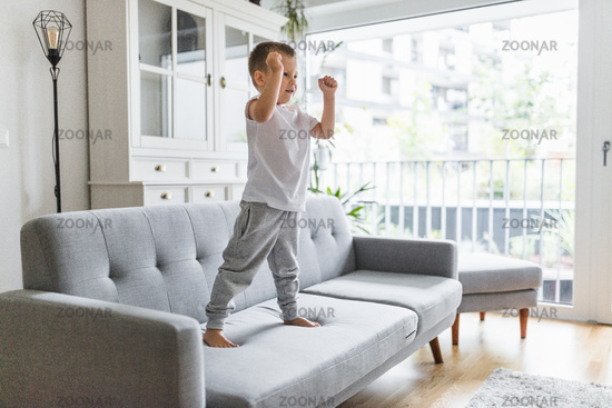 Cute child at home on sofa in the living room