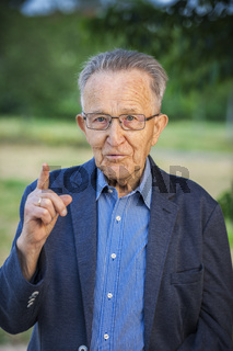 Pensioners with a raised index finger