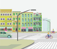City with road traffic, apartment buildings and cyclists