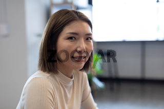 Asian businesswoman working in creative office