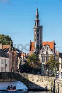 Tourists Enjoying a Boat Trip around Bruges