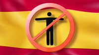 Forbbiden sign with crossed out man on a background Spanish flag.
