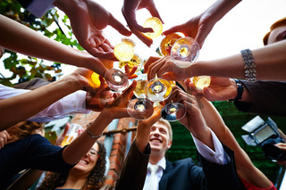 Wedding toast in circle. Everyone stood in a circle and choked with glasses.