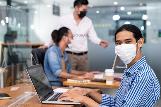 Asain employee face mask in new normal office